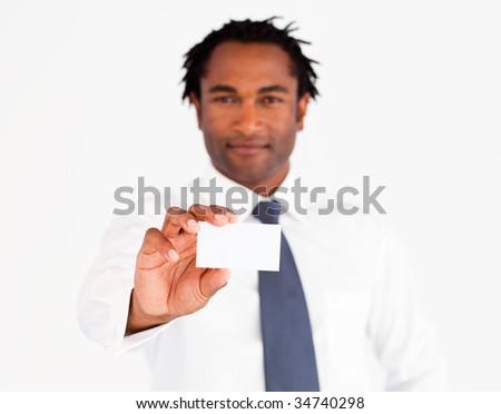 Young afro-american businessman showing his card, looking at the camera