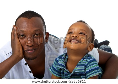 Young afro american family in a studio setting. - stock photo