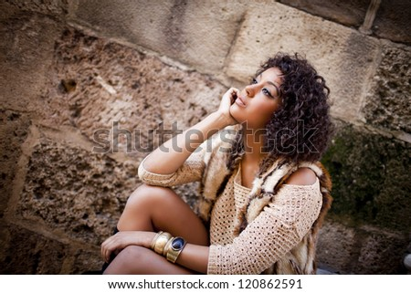 Young afro american girl in urban background - stock photo