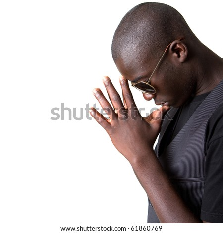 Young afro american teenager praying with sunglasses and a stylish suit. - stock photo