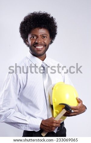 young afro engineer with helmet and hammer