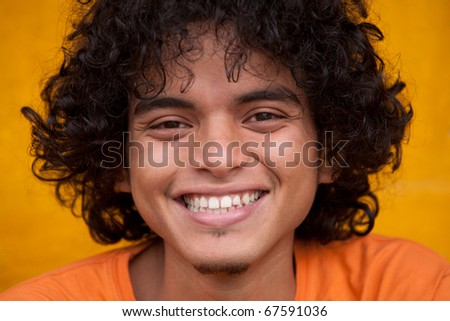 YOUNG AFRO MAN SMILING