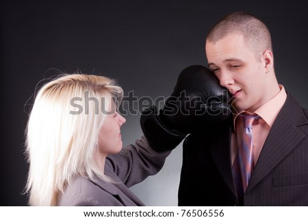 young agressive businesswoman hit businessman - stock photo