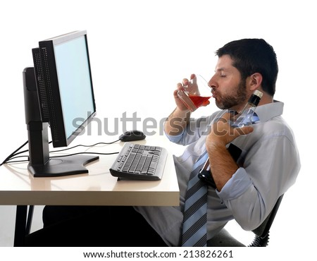 young alcoholic business man drinking whiskey sitting drunk at office with computer holding glass looking depressed wearing loose tie in alcohol addiction problem concept isolated white background - stock photo