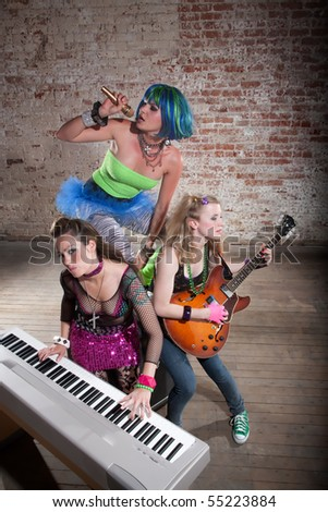 Young all girl punk rock band performing - stock photo