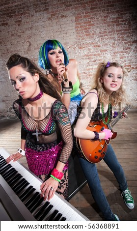 Young all girl punk rock band performs - stock photo
