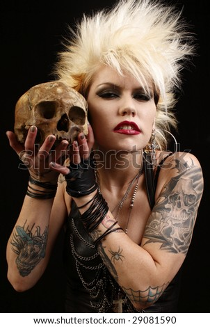 Young alternative woman with a skull. - stock photo