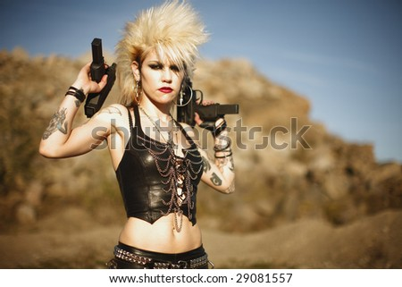 Young alternative woman with dual automatic pistols.