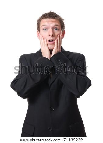 young amazed businessman isolated on white background - stock photo