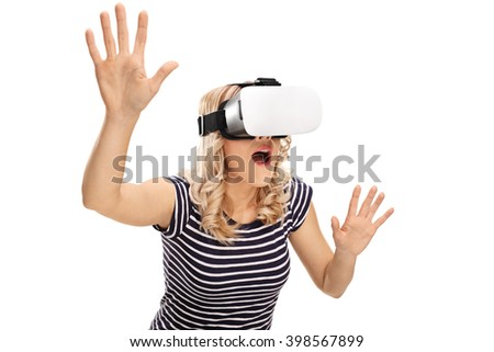 Young amazed woman experiencing virtual reality isolated on white background