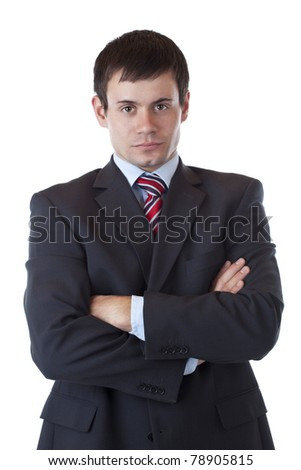 Young ambitious businessman looks at camera earnestly.Isolated on white background. - stock photo