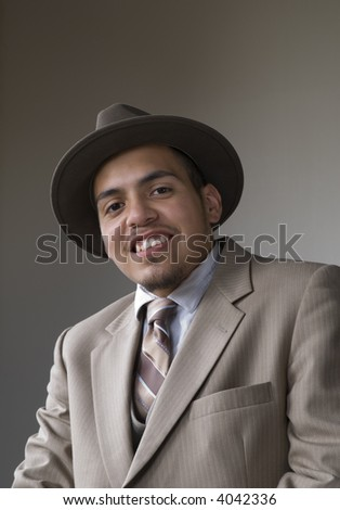 Young ambitious Latino male in suit
