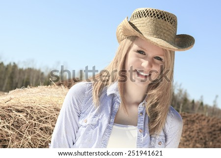 Young american cowgirl woman portrait outdoors. - stock photo