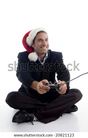 young american executive in christmas hat playing video game with white background - stock photo