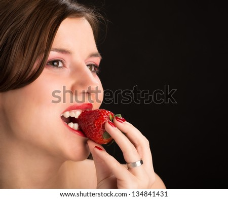 young an beautiful girl eat strawberries - stock photo