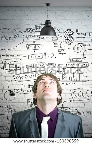young and atracctive entrepreneur have a idea - stock photo