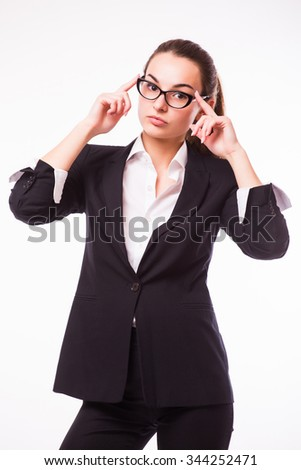 Young and attractive business woman in glasses isolated on white. Thinking and successful look.