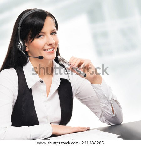 Young and attractive business woman with an electronic cigarette working in office isolated on white - stock photo