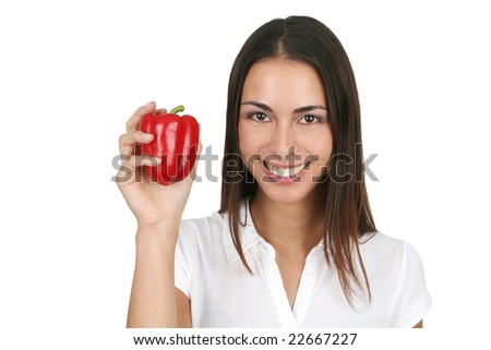 Young and attractive girl holding a red bell pepper. Isolated on white. - stock photo
