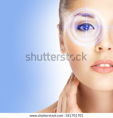 Young and attractive woman from future with the laser hologram on her eyes (collage about ophthalmology and eye scanning technology) - stock photo