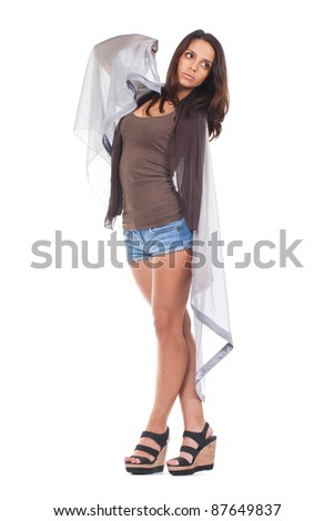 young and attractive woman posing wrapped in a grey scarf - stock photo