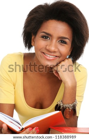 Young and beautiful afro woman studying with books - stock photo