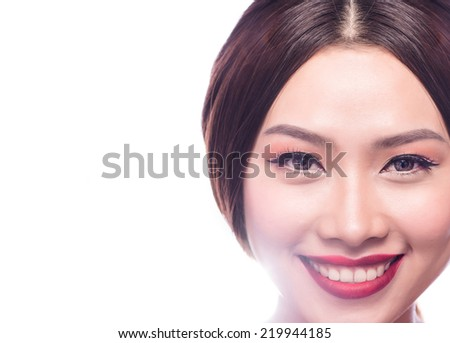 Young and beautiful asian woman with smiling. Woman makeup with blended red lip. Closeup of gorgeous Asian female model getting ready for a night out. Copy-spaced - stock photo