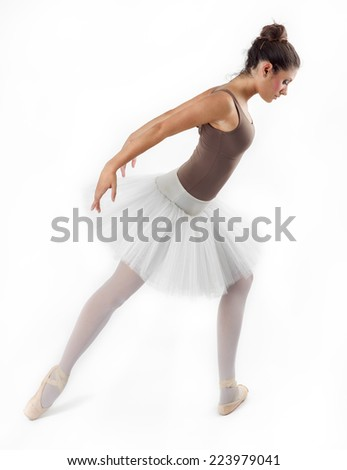 young and beautiful ballet dancer posing in studio
