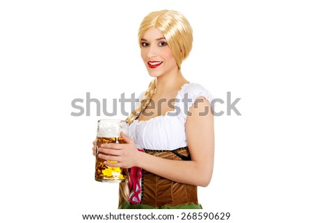 Young and beautiful bavarian woman with beer. - stock photo