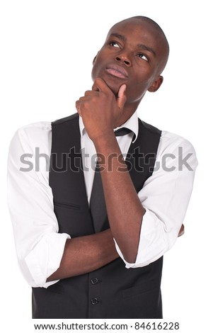 young and beautiful black man posing with his hand on the face - stock photo