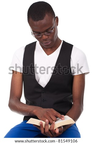 young and beautiful black man sitting nd reading  book - stock photo