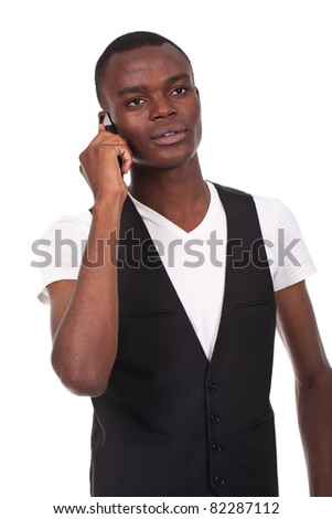 young and beautiful black man speaking on the phone - stock photo