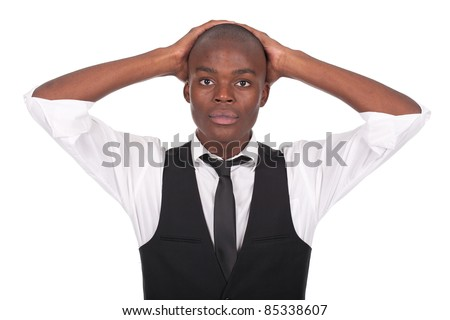 young and beautiful black man with his hands on the head - stock photo