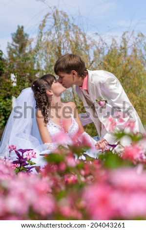 Young and beautiful bride and groom kissing - stock photo
