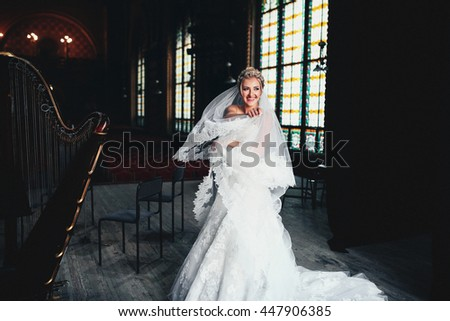 Young and beautiful bride on the scene of the theater - stock photo