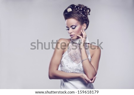 Young and beautiful bride standing in studio  - stock photo