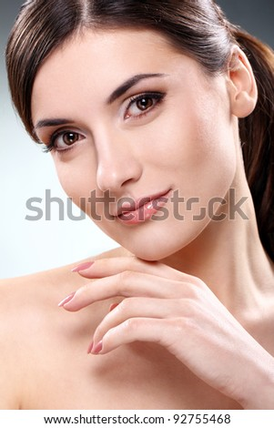 Young and beautiful brunette with clean face - stock photo