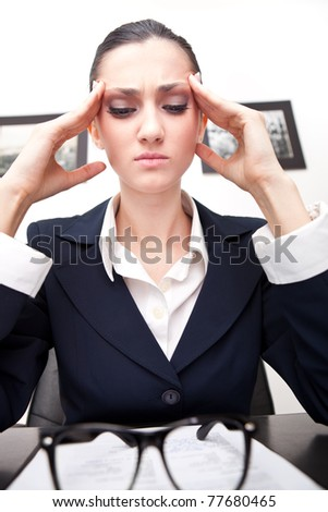 young and beautiful businesswoman tired from work in the office - stock photo