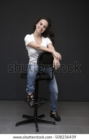Young and beautiful casual woman studio portrait