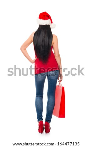 Young and beautiful Christmas shopper girl isolated on white background - stock photo