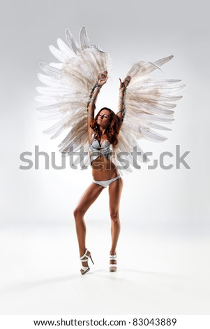 young and beautiful dancer posing in studio - stock photo