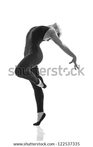 young and beautiful dancer posing in studio. Isolated - stock photo