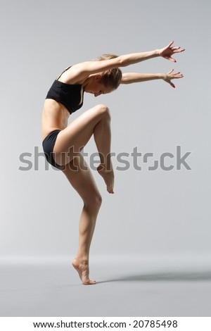 young and beautiful female ballet dancer posing