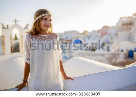 Young and beautiful girl in Oia - Santorini, Greece - stock photo