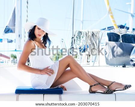 Young and beautiful girl on luxury yacht - stock photo
