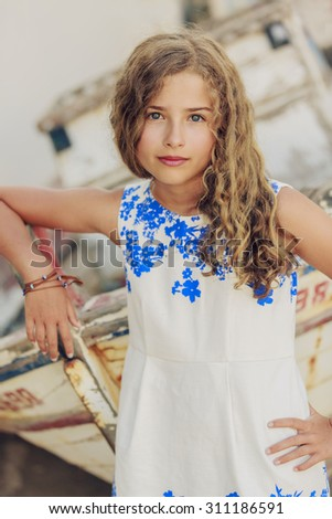 Young and beautiful girl - Santorini, Greece - stock photo