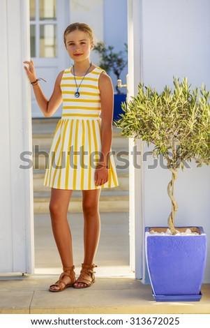 Young and beautiful girl, Santorini, Greece - stock photo