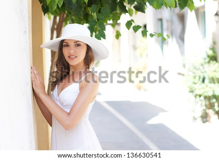 Young and beautiful lady walking down the ancient street - stock photo