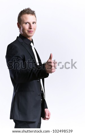 young and beautiful man making ok sign - stock photo