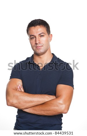 young and beautiful man standing with his arms crossed - stock photo
